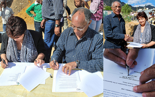 """international delegation, sign sbos </p> <p>New political actors have emerged that are influencing the national upgrading agenda. Among these are the Informal Settlement Network (ISN), a bottom-up agglomeration of local-level and national-level organisations of urban poor in Cape Town, Ekurhuleni, eThekwini (Durban), Johannesburg, Nelson Mandela Bay (Port Elizabeth), and Stellenbosch. ISN, together with the Federation of the Urban Poor (FEDUP) – a woman-led federation of slum dwellers practicing savings, enumerations and partnerships with the state – and support NGOs Community Organisation Resource Centre (CORC), iKayalami, and uTshani Fund, promote pro-poor and inclusive cities through people-centred development. These organisations are linked to Shack/Slum Dwellers International (SDI), a global network of similar organisations of the urban poor in 33 countries across Asia, Africa and Latin America. SDI builds partnerships with government that put shack dwellers at the centre of upgrading their built environment. As the South African SDI Alliance saying goes: """"Nothing for us without us"""".</p> <p>The Alliance promotes the establishment of citywide """"Urban Poor Funds"""" which are community-driven development funding facilities that support community-initiated projects. Urban Poor Funds are financed by contributions from the local municipality combined with the savings of the poor, and are often strengthened by international donor funding. These funds are co-managed between organised communities and the municipality, and tend to by-pass the red tape and costly bureaucracy of state delivery mechanisms. These precedent-setting funds build on the collective capacity of local savings groups and link local upgrading efforts to wider policy change. This form of development-finance has particularly gained currency in South East Asian countries where institutional innovation, transparency and accountability resulted in empowered communities and significant poverty alleviation. In"""