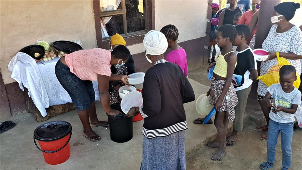 Residents wait for food parcels in Kwa Zulu Natal province