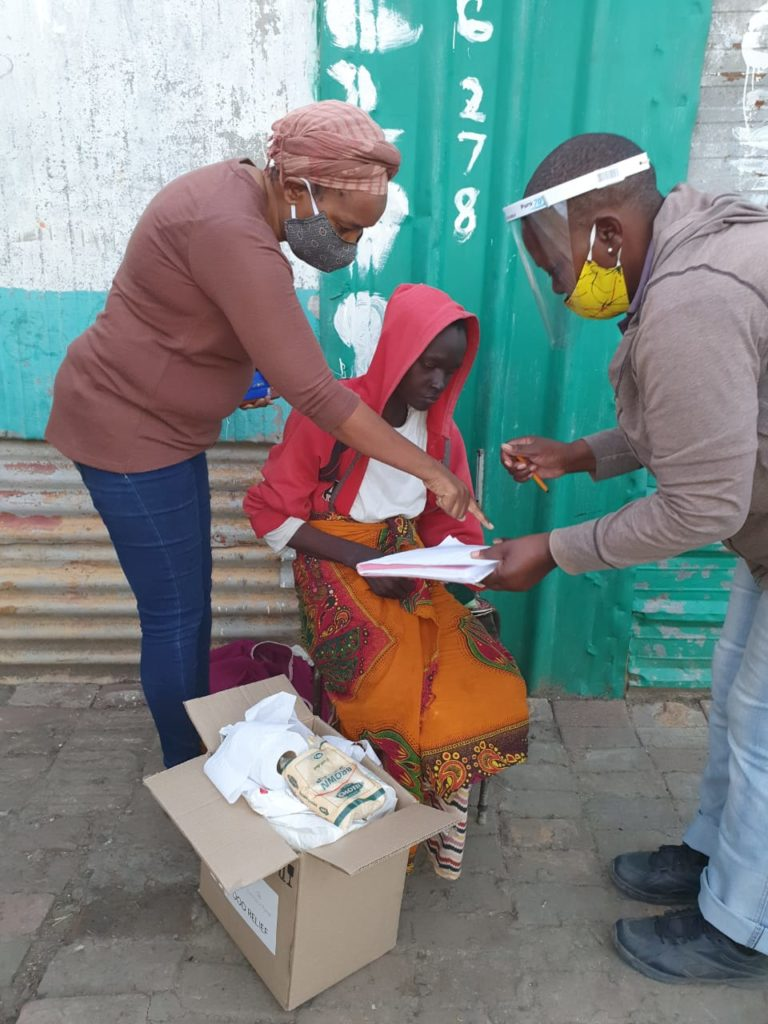 Distributing food parcels in North West