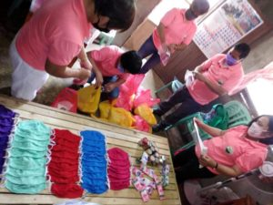 Making masks and food packs in Mindanao.